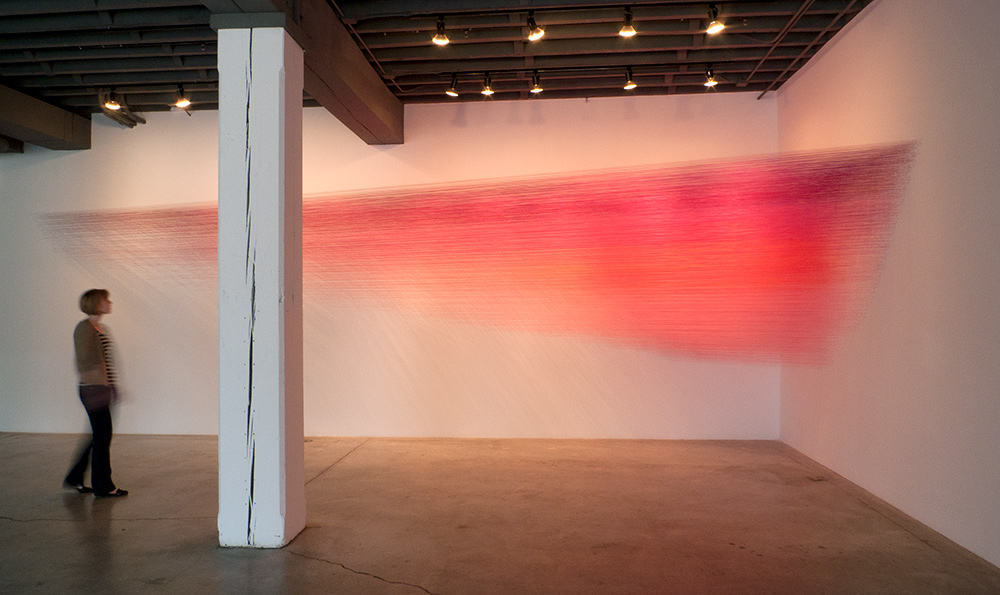 Drawn pink, 2012, Egyptian cotton head, staples, 35 by 6 by 10 feet.Photography by Derek Porter